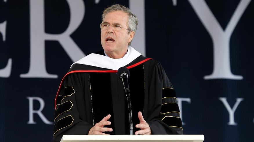 Former Florida Gov. Jeb Bush delivers the commencement address at Liberty University in Williams Stadium at the school in Lynchburg, Va., Saturday, May 9, 2015.   (AP Photo/Steve Helber)