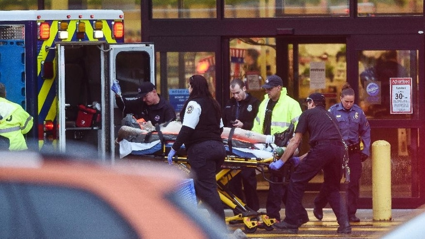 Paramedics load a man into an ambulance following a shooting inside Hobby Lobby off 8th Street in Colorado Springs, Colo. Friday, May 8, 2015. Police have said that everything is secure and safe at this time, but have not yet released additional details. (Michael Ciaglo/The Gazette via AP)