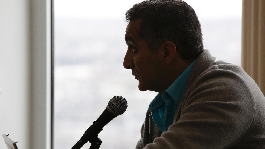 Bassem Youssef, who has been dubbed the Jon Stewart of Egypt for his biting political satire, participates in a discussion of satire and free speech Friday, May 1, 2015, in Boston. A resident fellow for the spring semester at Harvard University's Institute of Politics at the John F. Kennedy School of Government Youssef ended his popular Egyptian political satire show Al-Bernameg about a year ago, citing a fear for his and his family's safety. (AP Photo/Stephan Savoia)