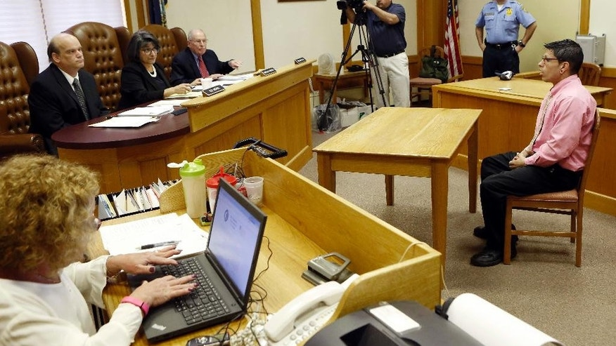 Autumn Savoy, seated right, speaks to the parole board Tuesday May 12, 2015 during his parole hearing at the state prison in Concord, N.H. Savoy, convicted of hiding evidence and concocting an alibi for machete-wielding home invaders who killed a woman and maimed her daughter was granted parole. (AP Photo/Jim Cole)