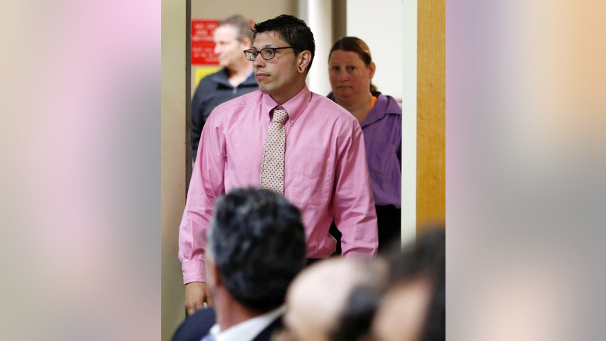 Autumn Savoy arrives Tuesday May 12, 2015 for his parole hearing at the state prison in Concord, N.H. Savoy, convicted of hiding evidence and concocting an alibi for machete-wielding home invaders who killed a woman and maimed her daughter was granted parole.(AP Photo/Jim Cole)