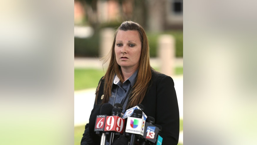 Lake Mary Police officer Bianca Gillett speaks to media about Monday's shooting involving George Zimmerman, Tuesday, May 12, 2015, in the Orlando suburb of Lake Mary, Fla. Police recovered a handgun from George Zimmerman and took two guns from a man accused of shooting at Zimmerman while both were driving, authorities said Tuesday. Detectives are still investigating and no charges have been filed against Zimmerman or Apperson. Documents released Tuesday show that detectives are investigating the shooting as a possible aggravated assault with a deadly weapon without intent to kill. (Charles King/Orlando Sentinel via AP) MAGS OUT; NO SALES