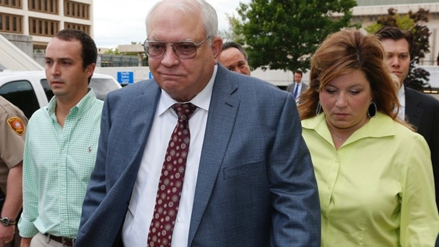 April 21: Robert Bates, second from right, leaves his arraignment in Tulsa, Okla. Bates, a 73-year-old Tulsa County reserve deputy, fatally shot a suspect who was pinned down by officers.