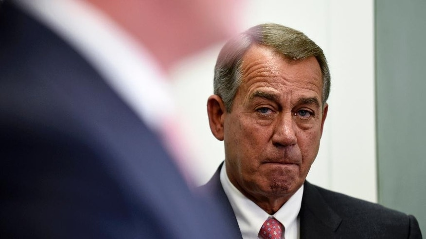 House Speaker John Boehner of Ohio listens during a news conference on Capitol Hill in Washington, Wednesday, May 13, 2015. The House debates and votes for final passage on NSA Surveillance legislation, known as the USA Freedom Act. The measure seeks to codify President Barack Obama's proposal to end the NSA's collection of domestic calling records. It would allow the agency to request certain records held by the telephone companies under a court order in terrorism investigations. (AP Photo/Susan Walsh)