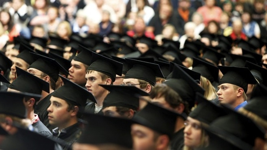 May 8, 2015: Graduates listen as U.S. President Barack Obama delivers a commencement address to the graduating class at Lake Area Technical Institute in Watertown, South Dakota. (REUTERS/Jonathan Ernst)