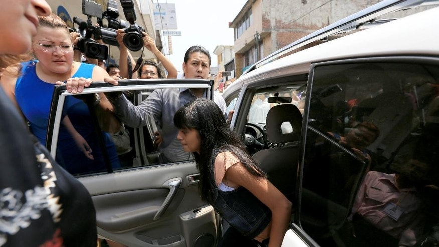 Alondra Diaz Garcia arrives for a court hearing in Los Reyes, Mexico, Tuesday, May 12, 2015. The teenage girl at the center of an international custody case won't be sent to the United States until Mexican authorities confirm her identity through DNA testing. The search for the 13-year-old attracted wide attention last month after a Mexican court erroneously sent another girl named Alondra to Texas in a case of mistaken identity. Dorotea Garcia, who lives in Houston, has been searching for her daughter since 2007 when the girl allegedly was taken into Mexico by her father. (Miguel Garcia Tinoco via AP)