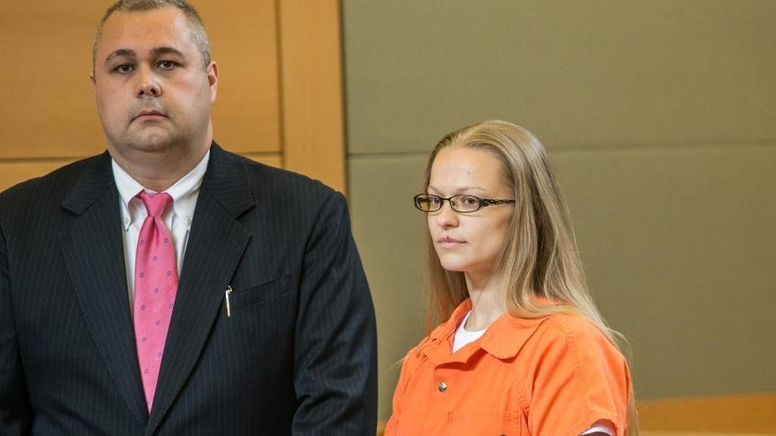 Angelika Graswald, right, stands in court with Michael Archer, a forensic scientist, as her attorneys ask for bail and to unseal the indictment against her during a hearing Wednesday, May 13, 2015, in Goshen, N.Y.  (AP)