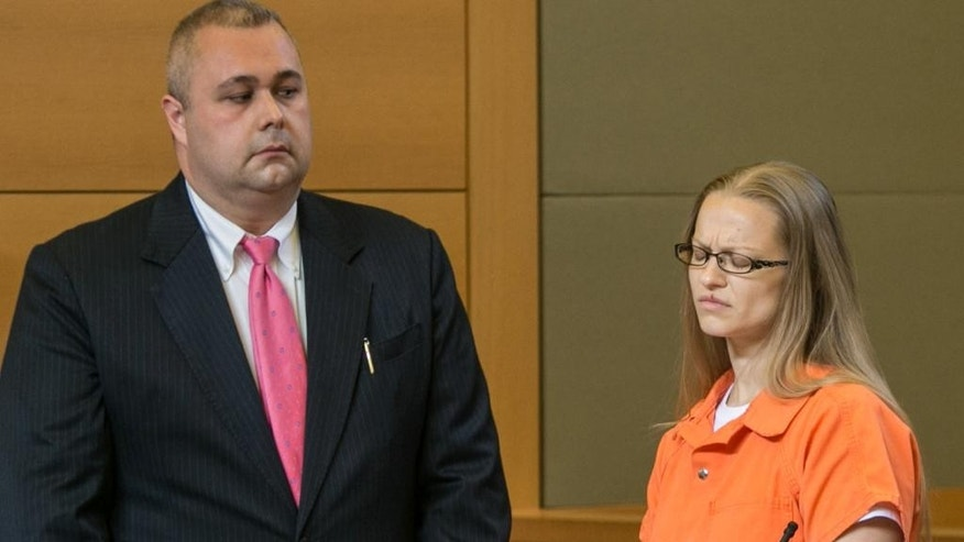 Angelika Graswald, right, stands in court with Michael Archer a forensic scientist, as her attorneys ask for bail and to unseal the indictment against her, during a hearing Wednesday, May 13, 2015, in Goshen, N.Y.  Graswald has been charged with second-degree murder in the disappearance of her fiance, Vincent Viafore while kayaking on the Hudson River. (Allyse Pulliam/Times Herald-Record via AP, Pool)