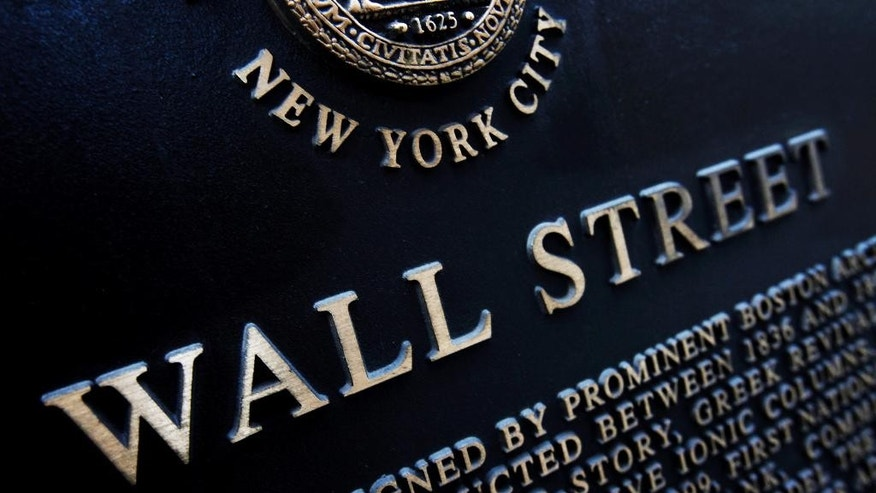 FILE - This Jan. 4, 2010 file photo shows an historic marker on Wall Street in New York. U.S. stocks edged higher in early trading Wednesday, May 13, 2015, following broad gains in European markets. (AP Photo/Mark Lennihan, File)