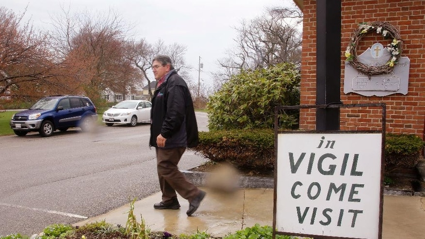 "In this Tuesday, May 5, 2015 photo, Marc Dean, a parishioner who has been in vigil at St. Frances Xavier Cabrini Church for the past five years, leaves after his shift is over, in Scituate, Mass. A Massachusetts judge on Thursday, May 14, 2015, has ordered parishioners of the St. Frances Xavier Cabrini Church to end their 11-year protest vigil and vacate the now-closed Roman Catholic church. In his ruling,  Superior Court Judge Edward Leibensperger said the parishioners are ""unlawfully and intentionally"" trespassing at the church in Scituate. (AP Photo/Stephan Savoia)"