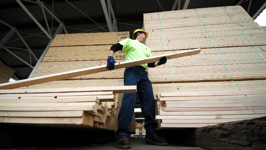 In this March 31, 2015 photo, Chuck Barrett helps a customer load 2x4's at the Allegheny Millwork and Lumberyard in Pittsburgh. The Labor Department releases the Producer Price Index for April on Thursday, May 14, 2015. (AP Photo/Gene J. Puskar)