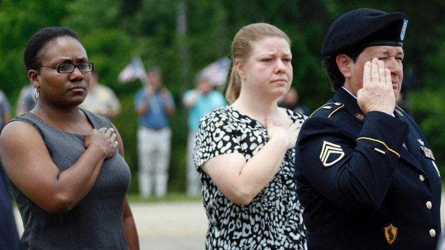 People pay their respects as the funeral procession passes for Hattiesburg Police Officer Benjamin Deen, Thursday, May 14, 2015, in Hattiesburg, Miss. Deen and fellow officer Liquori Tate were gunned down Saturday evening during a traffic stop. (AP Photo/Rogelio V. Solis)
