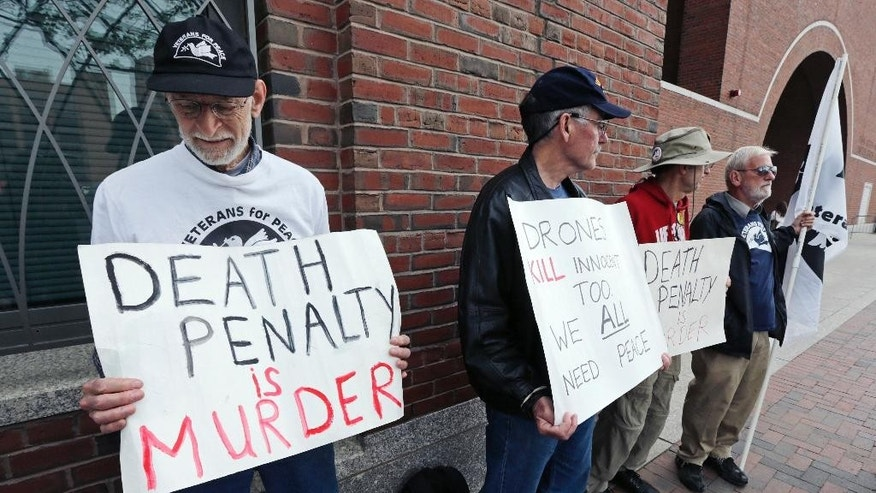 "A group from ""Veterans for Peace"" picket outside the Moakley Federal Courthouse as inside jury deliberations continue in the penalty phase of the trial of Boston Marathon bomber Dzhokhar Tsarnaev, Friday, May 15, 2015. The federal jury must decide whether the 21-year-old Tsarnaev should be sentenced to death or life in prison for his role in the deadly 2013 attack. (AP Photo/Charles Krupa)"