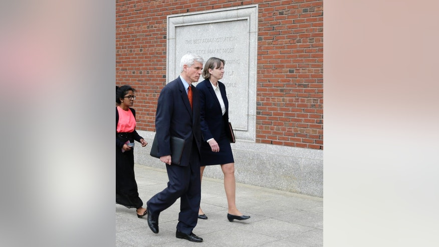 Defense attorneys David Bruck, left, and Judy Clarke, right, walk back to the Moakley Federal Court Friday, May 15, 2015, in Boston, after the U.S. Attorney's office announced that there was a verdict in the penalty phase of the trial of Boston Marathon bomber Dzhokhar Tsarnaev. The federal jury must decide whether the 21-year-old Tsarnaev should be sentenced to death or life in prison for his role in the deadly  attack in 2013. (AP Photo/Charles Krupa)