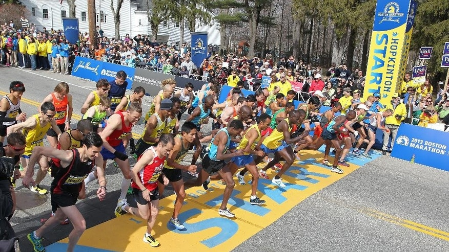 FILE - In this Monday, April 15, 2013 file photo, the elite men start the 117th running of the Boston Marathon in Hopkinton, Mass. (AP Photo/Stew Milne)