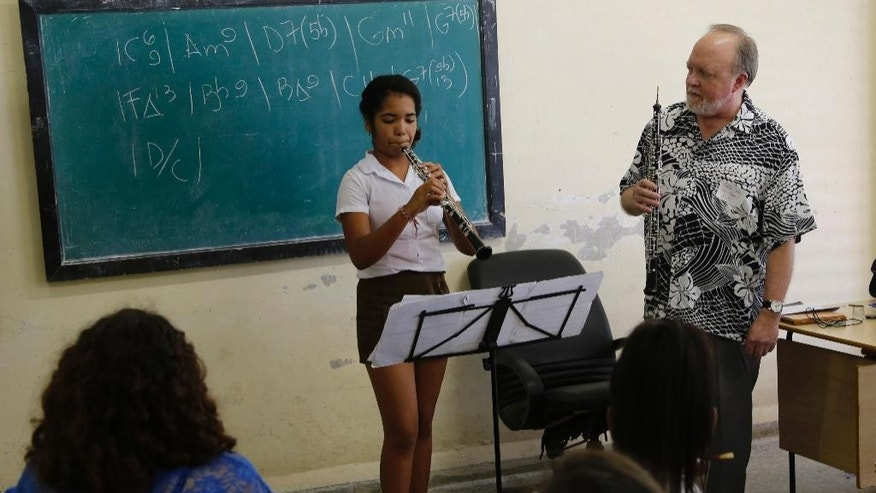 Cuban National Art School student Betsy Brizuela plays the oboe as Minnesota Orchestra oboe player John Snow conducts a master class in Havana, Cuba, Thursday, May 14, 2015. The Minnesota Orchestra will offer two concerts in Havana and is the first major U.S. orchestra to play in Cuba since 1999. The trip cost nearly $1 million. It was underwritten by Marilyn Carlson Nelson, an heir to the Carlson hotel company fortune, and her husband Glen. The U.S. government gave special permission for a direct charter flight from Minneapolis to Havana for the event, putting 4 tons of equipment and 160 people on an Airbus 330. (AP Photo/Desmond Boylan)