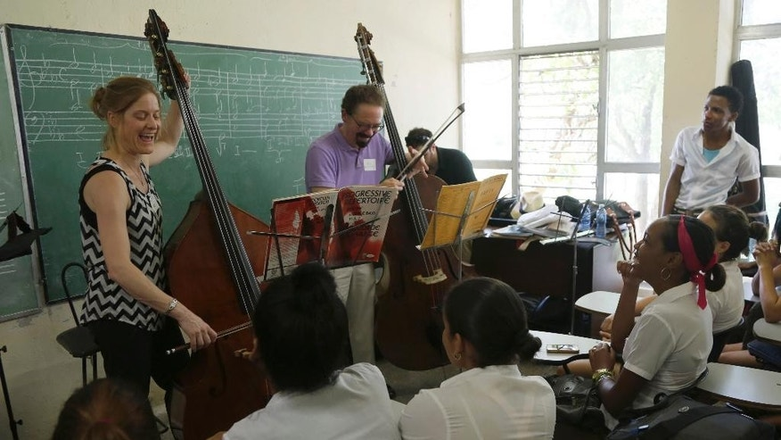 Minnesota Orchestra bass players Kristen Bruya, left, and Bill Schrickel play for music students of the National Art School during a master class in Havana, Cuba, Thursday, May 14, 2015. The Minnesota Orchestra will offer two concerts in Havana and is the first major U.S. orchestra to play in Cuba since 1999. The Minnesota Orchestra also played Havana in 1929 and 1930, when it was called the Minneapolis Symphony. (AP Photo/Desmond Boylan)