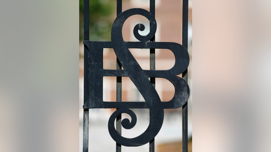 This photo taken on Wednesday, May 13, 2015, shows the ironwork front gates of Sweet Briar College, which were moved to a walkway at the school in Sweet Briar, Va, The school is scheduled to close in August with the final commencement ceremonies Saturday, May 16.   (AP Photo/Steve Helber)