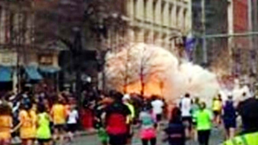 FILE - In this image from video provided by WBZ TV, a bomb explodes near the finish line of the Boston Marathon in Boston on Monday, April 15, 2013. On Friday, May 15, 2015, Dzhokhar Tsarnaev was sentenced to death by lethal injection for the terror attack. (WBZ-TV via AP) MANDATORY CREDIT: WBZ-TV
