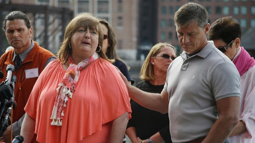 Liz Norden talks about how she watches her two sons put their legs on every day as she is consoled by first responder Mike Ward while speaking to members of the media after the death penalty verdict for Dzhokhar Tsarnaev outside the John Joseph Moakley United States Courthouse Friday, May 15, 2015, in Boston. Tsarnaev was charged with conspiring with his brother to place two bombs near the Boston Marathon finish line that killed three and injured 260 spectators in April 2013. (AP Photo/Stephan Savoia)