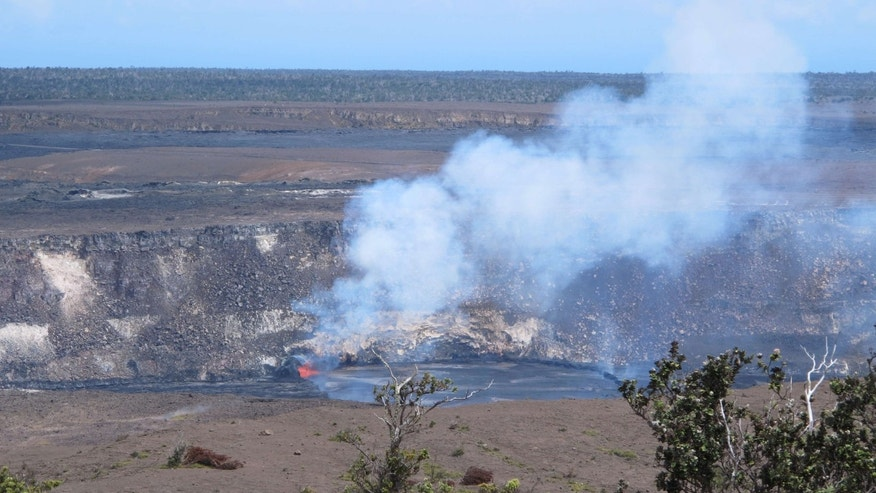 May 9, 2015: Molten rock spews into a lake of lava near the summit of Kilauea volcano on Hawaii's Big Island.