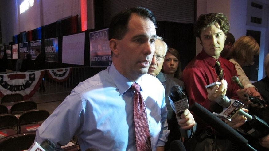 Gov. Scott Walker takes questions before his speech at the Wisconsin Republican Party convention on Saturday, May 15, 2015, in La Crosse, Wis. Breaking with tradition, Walker spoke to about 1,000 people at the center of the convention floor, rather than from the stage. Walker did not make reference to his own likely presidential run. But he did call on conference attendees to work to help Republicans win the White House next year. No Republican for president has carried Wisconsin since 1984. (AP Photo/Scott Bauer)