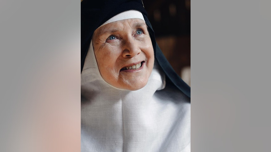 In this Friday, May 15, 2015 photo, Mother Dolores Hart poses for a photograph at the Abbey of Regina Laudis, in Bethlehem, Conn. Mother Dolores, a former actress who is best known for sharing the first on-screen kiss with Elvis Presley, has helped the Abbey which is in need of renovations gain exposure and aid from fans of Presley. (AP Photo/Jessica Hill)