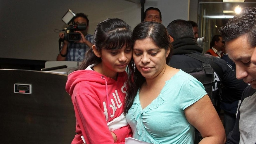 Houston resident Dorotea Garcia and 13-year-old Alondra Diaz stand together after passing through a security check at the international airport in Guadalajara, Mexico, early Saturday May 16, 2015. Garcia got her long-missing daughter back and headed for home, concluding an eight-year search after Alondra was taken to Mexico in 2007 by her father, Reynaldo Diaz, without her mother's consent, and her whereabouts had not been known until recently. The case gained international attention last month after Mercado erroneously ruled that 14-year-old Alondra Luna was the missing girl and ordered her turned over to Garcia. (AP Photo)