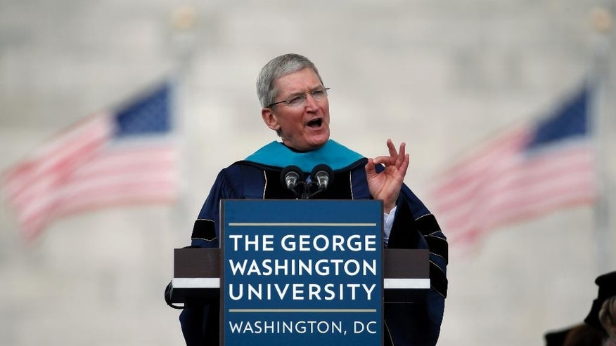 Apple CEO Tim Cook addresses graduates during George Washington University's commencement exercises on the National Mall, Sunday, May 17, 2015 in Washington. (AP Photo/Alex Brandon)