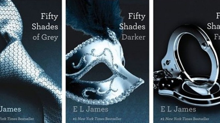 This combo made of book cover images provided by Vintage Books shows the 'Fifty Shades of Grey'; trilogy by best-selling author E L James. (AP/Vintage Books)