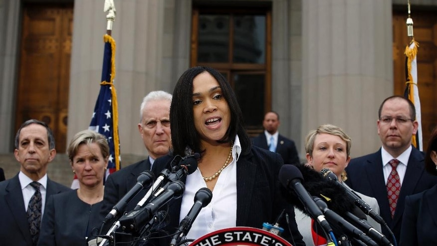 FILE - In this May 1, 2015 file photo, Baltimore state's attorney Marilyn Mosby speaks in Baltimore. A few miles off in any direction, and the debate about the knife involved in Freddie Gray's arrest by Baltimore police may have been completely different. The state of Maryland has one set of laws governing knives. The city of Baltimore has its own rules. Caught in the middle are people like Gray, who probably have no idea whether carrying a legally purchased knife can lead to criminal charges. (AP Photo/Alex Brandon, File)