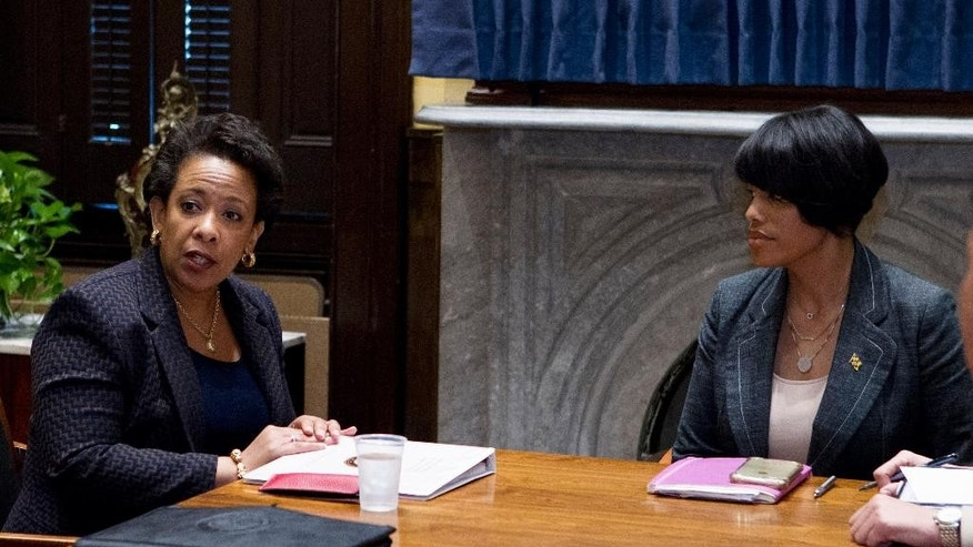 FILE - In this May 5, 2015 file photo, Attorney General Loretta Lynch, left, accompanied by Baltimore Mayor Stephanie Rawlings-Blake speaks during a work meeting at Baltimore City Hall in Baltimore. A few miles off in any direction, and the debate about the knife involved in Freddie Gray's arrest by Baltimore police may have been completely different. The state of Maryland has one set of laws governing knives. The city of Baltimore has its own rules. Caught in the middle are people like Gray, who probably have no idea whether carrying a legally purchased knife can lead to criminal charges.   (AP Photo/Jose Luis Magana, File, Pool)