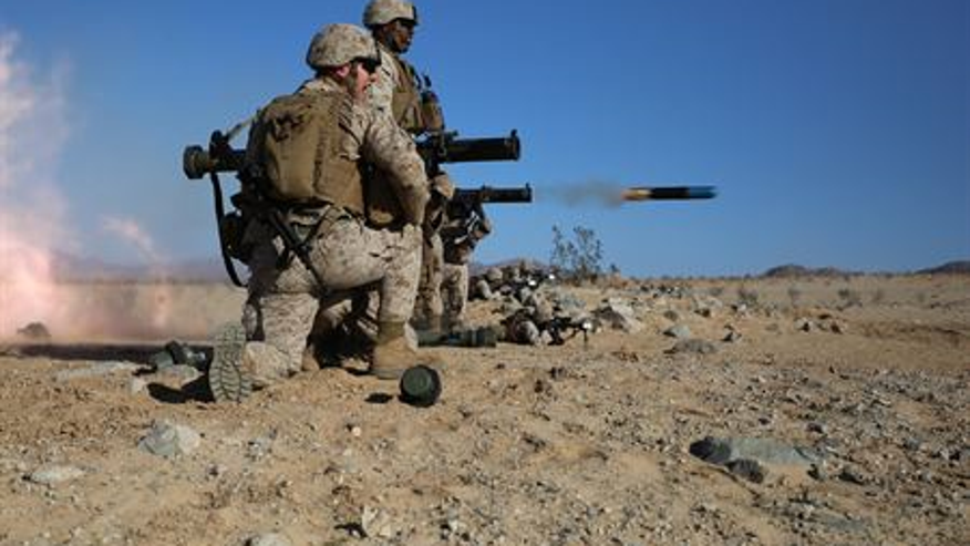 Anti-tank missileman fires the MK153 shoulder-launched multipurpose assault weapon (SMAW) during the enemy counter attack portion of a Marine Corps Operational Test and Evaluation Activity assessment at Marine Corps Air Ground Combat Center, Twentynine Palms, March 7, 2015. (U.S. Marine Corps photo by Sgt. Alicia R. Leaders/Released)