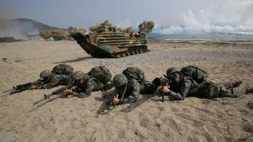 FILE - In this March 30, 2015 file photo, South Korean Marines take their position near an amphibious assault vehicle during the annual U.S.-South Korea joint military exercise Foal Eagle in Pohang, south of Seoul, South Korea. Amphibious military capabilities are on the agenda the week of May 18, 2015, as the U.S. Marine Corps and Navy host defense leaders from around the Pacific in Hawaii. (AP Photo/Lee Jin-man, File)