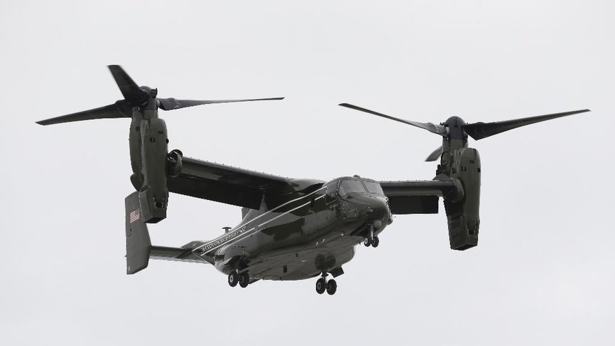 In this April 22, 2015 photo, a Marine Corps MV-22 Osprey comes in for a landing at Miami International Airport before a presidential visit, in Miami. A fatal crash of a U.S. Marine Corps aircraft in Hawaii has renewed safety concerns in Japan, where more of the Ospreys will be deployed. A tilt-rotor MV-22 Osprey caught fire after a hard landing on Sunday, May 17, 2015, killing one Marine and injuring 21 others at Bellows Air Force Station on Hawaii's main island of Oahu. (AP Photo/Wilfredo Lee)