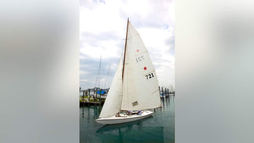 This July 29, 2014 handout photo provided by Heritage Auctions shows John F. Kennedy's Star Class Sailboat, Flash II, which he owned and raced with older brother Joseph P. Kennedy in the Nantucket Sound Star Fleet between 1934 and 1940. It will be offered for auction on Monday, May 18, 2015, in Dallas, by Heritage Auctions. ( Don Hoffman/Heritage Auctions via AP)