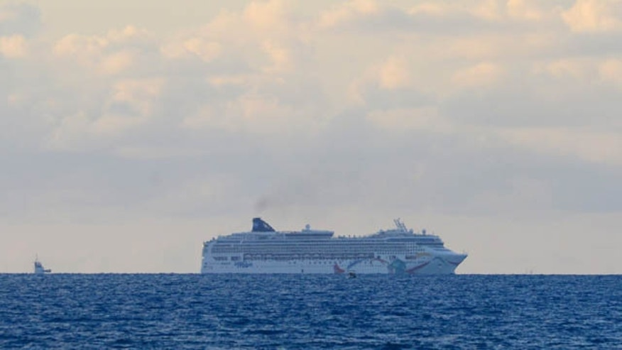 May 19, 2015: In this photo provided by the Royal Gazette, the Norwegian cruise ship Norwegian Dawn, lies aground near Bermuda's North Channel.