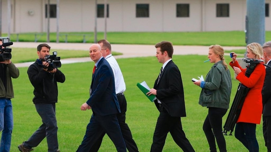 Nebraska Gov. Pete Ricketts, third left, is accompanied by Warden Brian Gage, in white shirt, during a tour of the Tecumseh State Correctional Institution in Tecumseh, Neb., Tuesday, May 19, 2015. The tour took place a little more than a week after a riot at the prison left two inmates dead. (AP Photo/Nati Harnik)