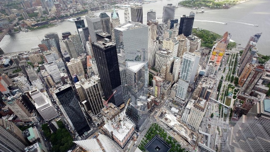 The Financial District and the World Trade Center, lower center, are seen from the observatory at One World Trade Center, Wednesday, May 20, 2015, in New York. The observatory atop the 104-story skyscraper opens to the public on May 29. (AP Photo/Mark Lennihan)