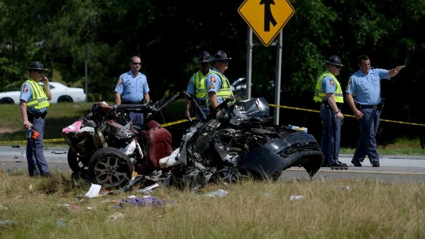 Multiple police officers  investigate a car involved in a multiple car accident on I-16 in Pooler, Ga. on Tuesday, May 19, 2015. (Ian Maule/Savannah Morning News via AP) MANDATORY CREDIT THE EXAMINER.COM; SFEXAMINER.COM AND WASHINGTONEXAMINER.COM