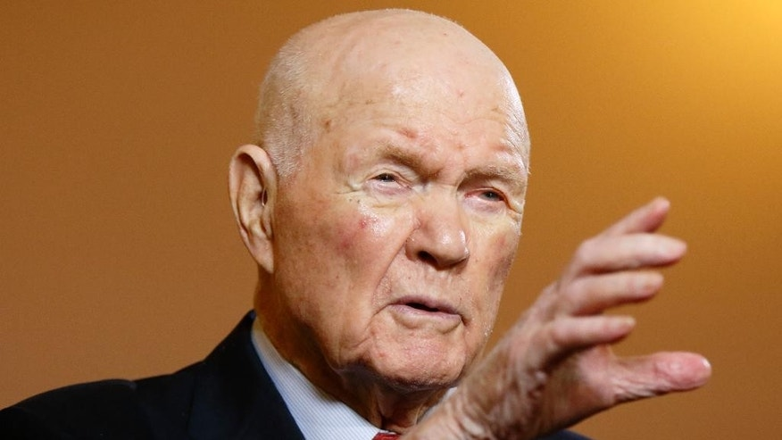 """In this photo taken on Thursday, May 14, 2015, former astronaut and senator John Glenn gestures while answering questions during an exclusive interview with The Associated Press at the Ohio Statehouse. Glenn said facts about scientific discovery should be taught in schools - and that includes evolution. The 93-year-old said that he sees no contradiction between believing in God and believing in evolution. When he went back into space in 1998, he had announced that """"to look out at this kind of creation out here and not believe in God is to me impossible.""""  (AP Photo/Paul Vernon)"""
