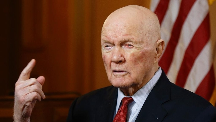"""In this photo taken on Thursday, May 14, 2015, former astronaut and senator John Glenn answers questions during an exclusive interview with The Associated Press at the Ohio Statehouse. Glenn said facts about scientific discovery should be taught in schools - and that includes evolution. The 93-year-old said that he sees no contradiction between believing in God and believing in evolution. When he went back into space in 1998, he had announced that """"to look out at this kind of creation out here and not believe in God is to me impossible.""""   (AP Photo/Paul Vernon)"""