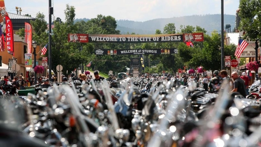 FILE - This Aug. 1, 2014 file photo shows motorcycles lined up in Sturgis, S.D., for the 74th annual Sturgis Motorcycle Rally that draws thousands of enthusiasts. A motorcycle gang shootout in Texas that left nine dead has elevated security concerns for the upcoming rally, authorities told the Argus Leader newspaper. (AP Photo/Toby Brusseau, File)