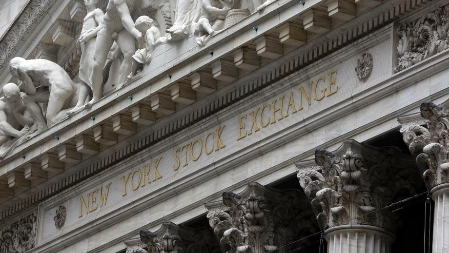 FILE - This Oct. 2, 2014 file photo shows the facade of the New York Stock Exchange, in New York. Stocks are opening mostly lower Wednesday, May 20, 2015, as traders look over some disappointing company results. (AP Photo/Richard Drew, File)