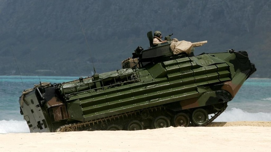 A U.S. Marine amphibious assault vehicle climbs ashore at Bellows Air Force Station on Oahu, Hawaii during joint amphibious exercises, as the U.S. Marine Corps and Navy host defense leaders from around the Pacific, Tuesday, May 19, 2015. The first-of-its kind meeting comes as territorial disputes over islands are growing more heated in the region. (AP Photo/Caleb Jones)