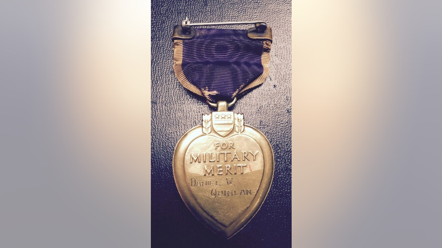This May 11, 2015 photo provided by Zachariah Fike of Purple Hearts Reunited shows Pvt. Daniel Quinlan's Purple Heart. The medal, one of the first Purple Heart medals ever awarded to American military personnel is being returned to a relative of Quinlan's, who received it for wounds suffered during World War I.