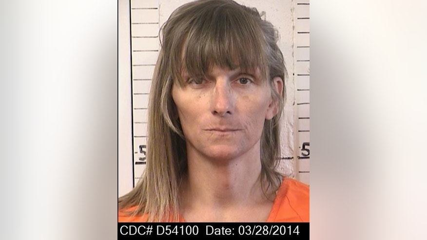 FILE - This March 28, 2014, file photo, provided by the California Department of Corrections and Rehabilitation shows Michelle-Lael Norsworthy. On April 2, 2015 a federal judge ordered California's corrections department to provide the transsexual inmate with sex change surgery, the first time such an operation has been ordered in the state. Now Norsworthy faces the awful irony: If she wins freedom from a parole board Thursday, May 21, 2015, after 28 years in prison, she would no longer be eligible for the prison-funded operation she says is crucial to her emotional health. (California Department of Corrections and Rehabilitation via AP Photo)
