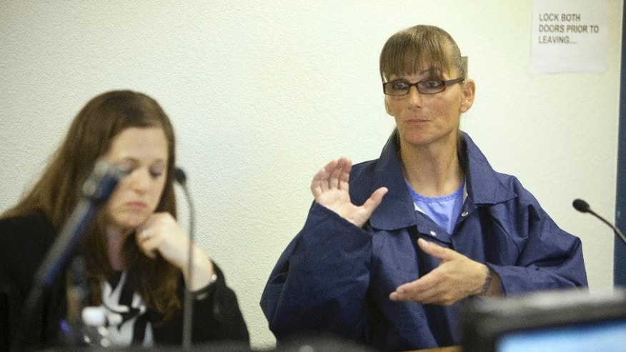 Inmate Michelle-Lael Norsworthy, right, speaks as her attorney Kate Brosgart listens during her parole hearing at Mule Creek State Prison in Ione, Calif., Thursday, May 21, 2015. A federal judge ordered The California Department of Corrections and Rehabilitation to provide the transgender inmate with sex reassignment surgery, the first time such an operation has been ordered in the state. The parole board granted Norsworthy's request for parole which could change her possibility of surgery while in custody. (AP Photo/Steve Yeater)