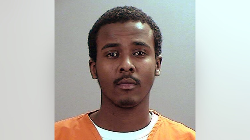 "This undated photo provided the Sherburne County, Minn., Sheriff's Office shows Abdirahman Yasin Daud, one of several Minnesota men accused of conspiring to travel to Syria to join the Islamic State group. Court documents filed Thursday, May 21, 2015, by prosecutors said Daud told friends he'd ""spit on America"" at the U.S.-Mexico border. (Sherburne County Sheriff's Office via AP)"