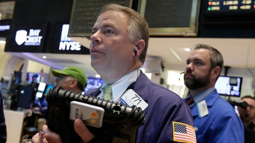 Trader F. Hill Creekmore, center, works on the floor of the New York Stock Exchange Thursday, May 21, 2015. U.S. stocks edged higher in early trading. Energy stocks rose more than the rest of the market as the price of oil climbed. (AP Photo/Richard Drew)